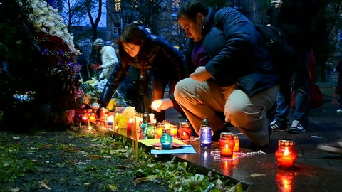 KIEV, UKRAINE - NOV 14, 2015: Flowers and candles memorable memorial set up near the French Embassy in Kiev,Ukraine on November 14,2015 for the victims killed in attacks in Paris (France) on 13.11.15.