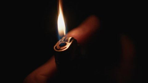 Cigarette Lighter Being Lit in the Dark & Glowing. Close Up, Super Slow Motion 2