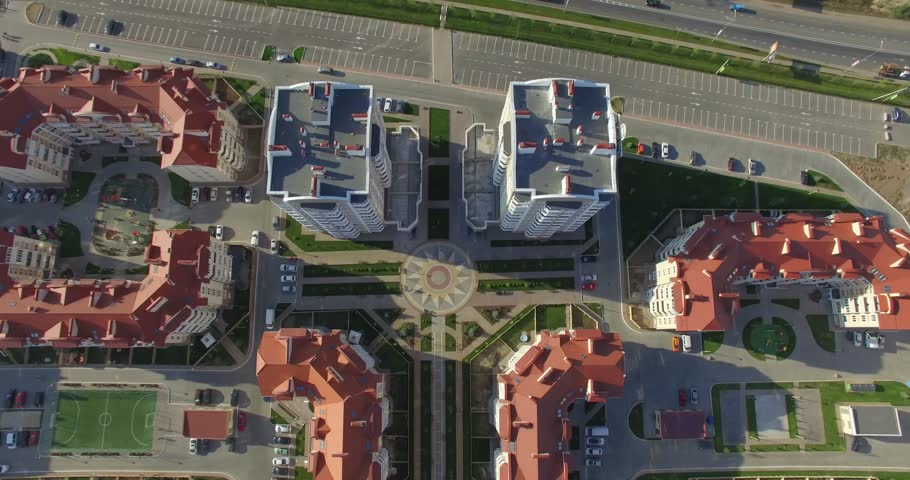Large modern middle class residential area (Aerial, 4K). Flying above and inside new residential area