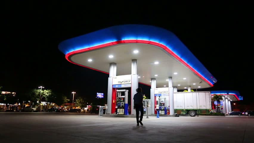 CHONBURI,THAILAND- NOVEMBER 20, 2015: Time lapse of PTT gas station with vehicle on night time at high way road during Chonburi city to Bangkok city , Chonburi ,Thailand | Shutterstock HD Video #12919667