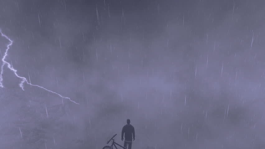 Cyclist on top of the mountain, storm with lightning