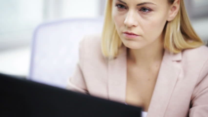 Business, people, stress, problem and technology concept - young businesswoman with computer working at office | Shutterstock HD Video #12929537