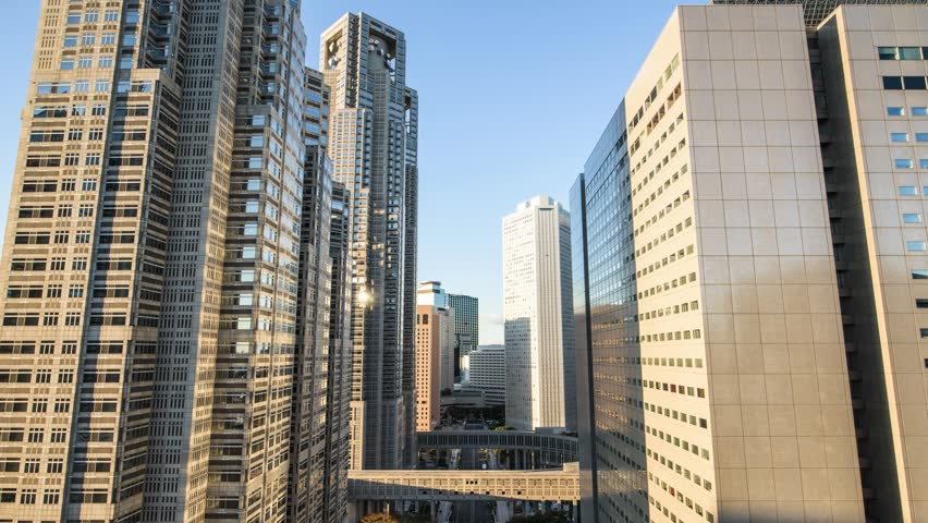Time-lapse night to day of office buildings in East Shinjuku, Tokyo, Honshu, Japan 4K UHD