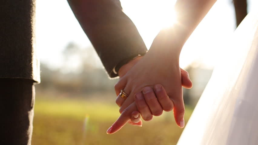 Young couple holding hands,  shot in slow motion