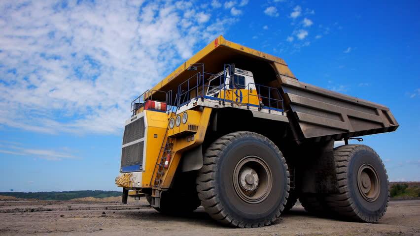 Mining dump trucks in the open pit mine