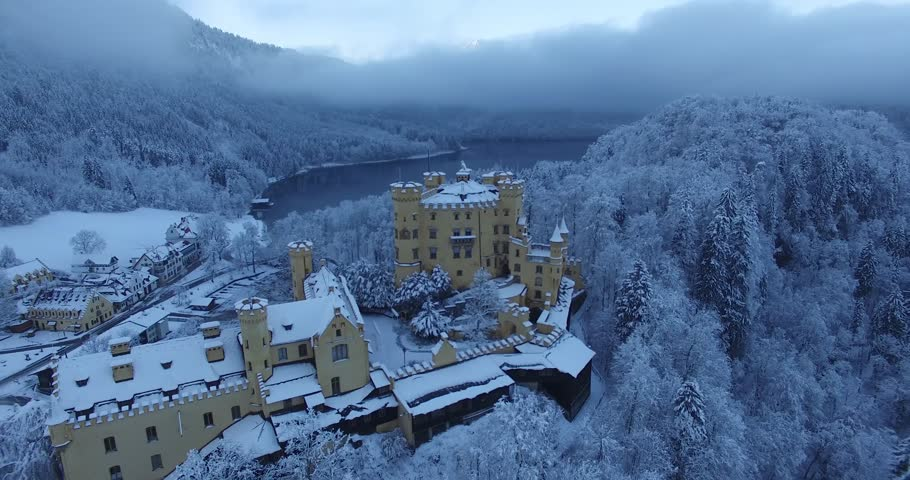 Aerial view of  Hohenschwangau Castle at sunrise in winter landscape. Germany