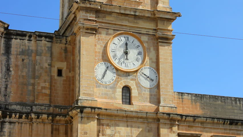 Calendar clock on one of the bell towers of St John Co-Cathedral in Valletta the capital of the island of Malta