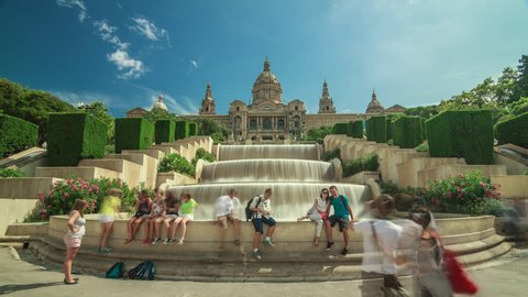 Timelapse (time lapse, time-lapse) of MNAC (Museu Nacional d'Art de Catalunya) with fountain and tourists doing selfie in Barcelona, Spain.