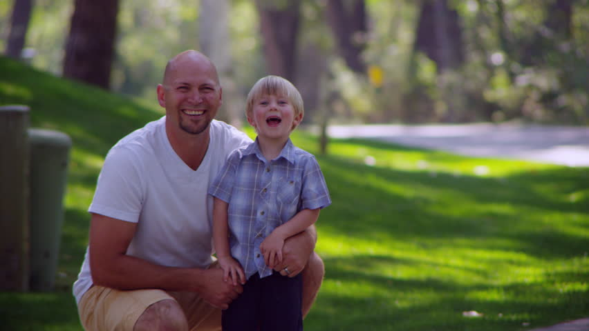 Portrait of father and son smiling | Shutterstock HD Video #13068137