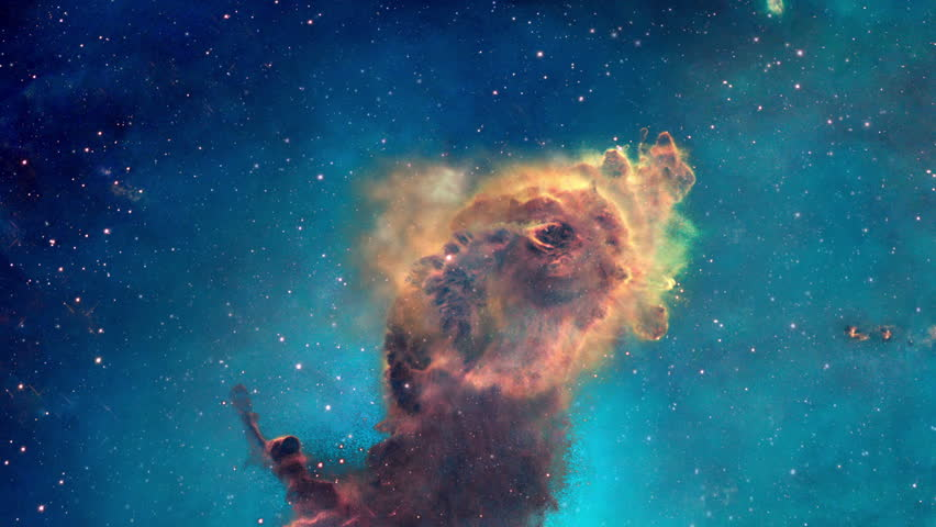The viewer looks at a portion of the Carina nebula from different angles, its pillars of gas and dust can be seen in three dimensions.  Original image used with permission from NASA's Hubble site.   | Shutterstock HD Video #13081076