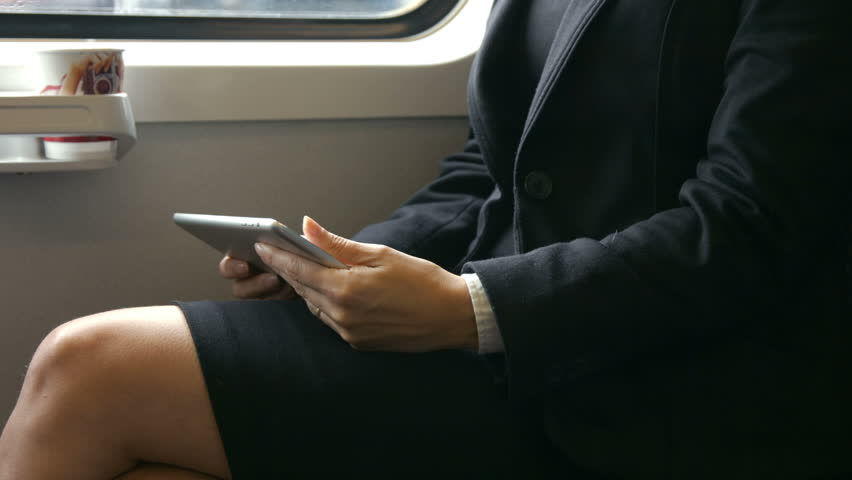 Businesswoman using her tablet on the train in high quality format | Shutterstock HD Video #13106477