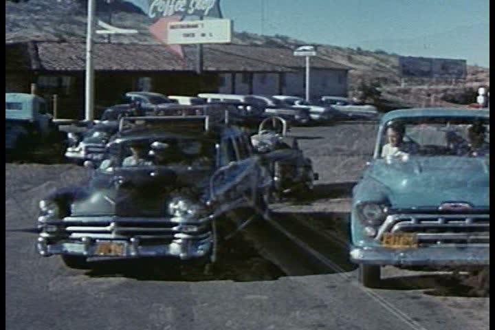 A Car Salesman Shows Couple 1953 Chevrolet Automobile On Set