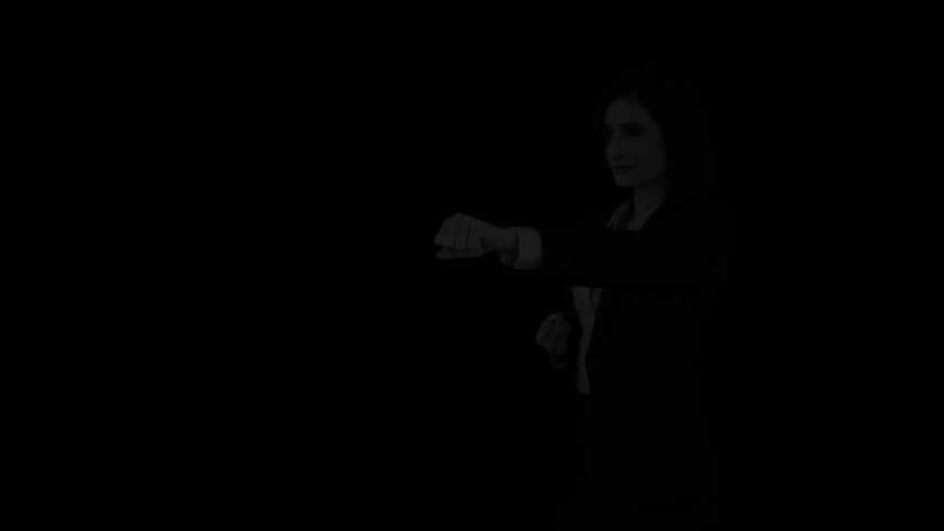 Tough businesswoman punching on flaming background | Shutterstock HD Video #13122167