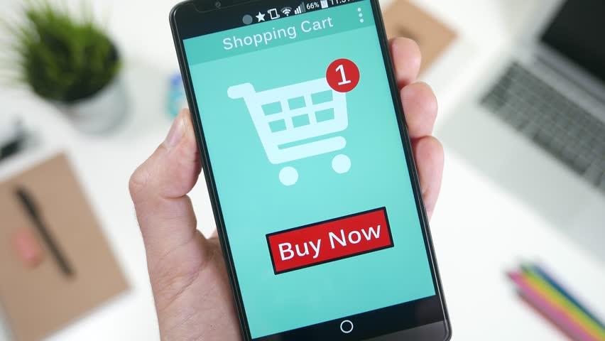 Pressing the Buy Now button to shop and pay a online store on smarrtphone.