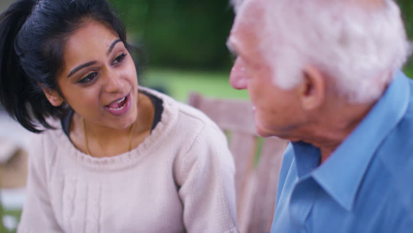 4K Caring young home support worker spending time with elderly gentleman in the garden. Shot on RED Epic | Shutterstock HD Video #13177040