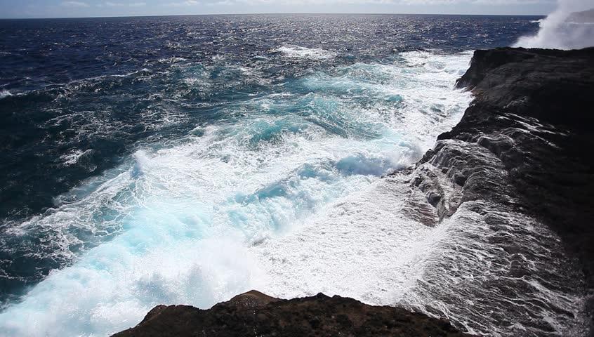Ocean waves crash over a rocky shore. #1320580