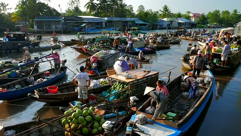 Mekong Delta - May 2015: Floating market with vendors on boats. 4K resolution
