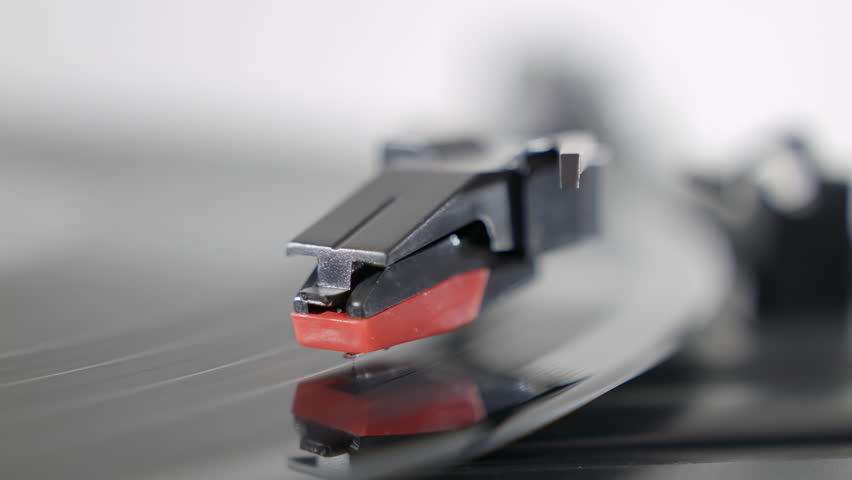 Record player turntable HD stock footage. A record player turntable with it's stylus running along a vinyl record   Shutterstock HD Video #13219874