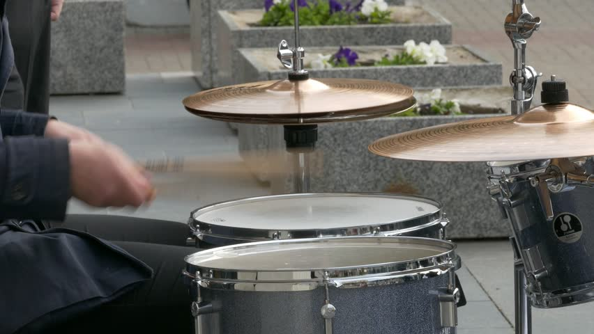 Ungraded: Jazz drummer playing the drum set in the open air. Arms close-up. Source: Lumix DMC, ungraded H.264 from camera without re-encoding. (av14363u)