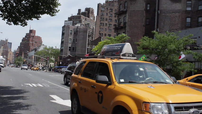 Driving Plate of New York West Village on 7th Avenue from Bleecker Street to Grand. 3/4 Back Left. Day with traffic, pedestrians, and buildings. 24fps. PR 422., New York, NY - May, 2014