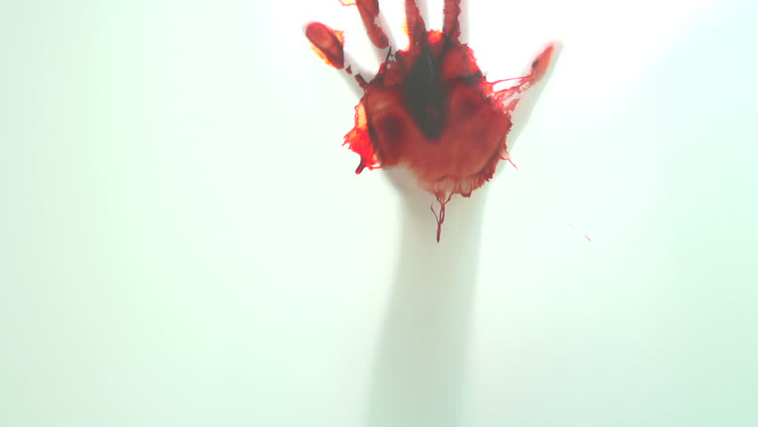 Bloody hand on glass window