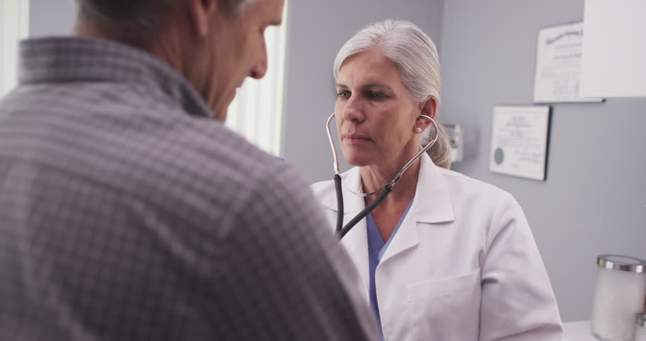 Medical doctor checking patient's heart rate | Shutterstock HD Video #13244921