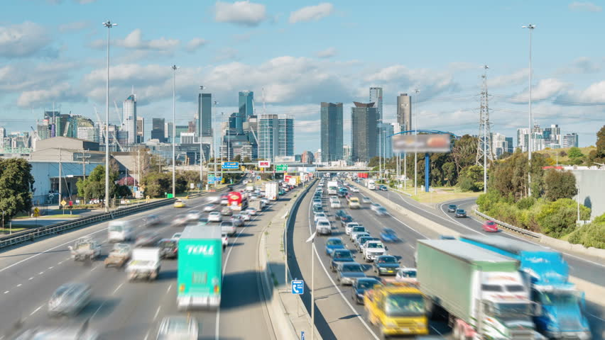 Timelapse video of highway traffic congestion and cbd of a city