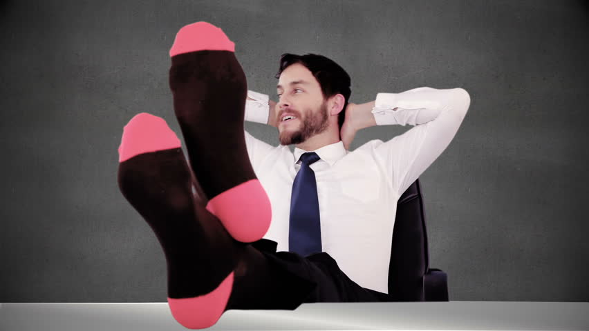 Smiling businessman relaxing himself at the desk | Shutterstock HD Video #13256777