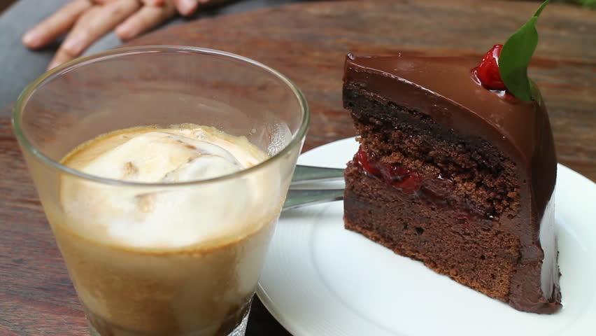 Having coffee break with affogato espresso and black forest cake, stock video #13258022