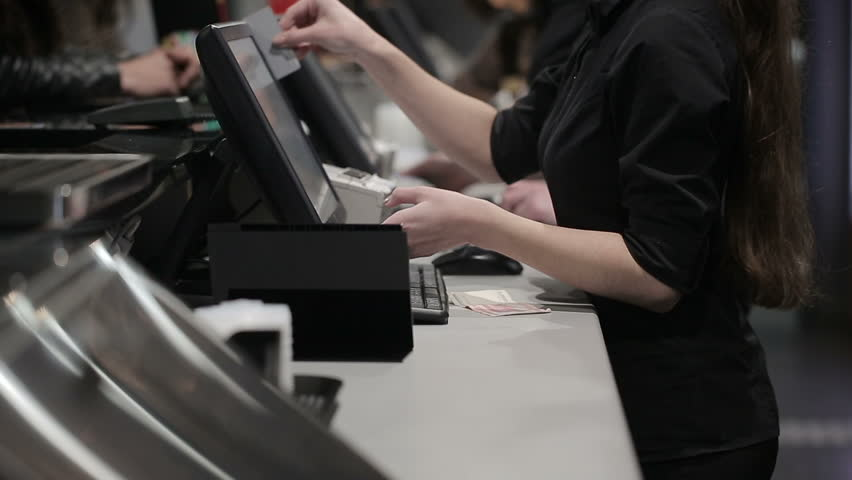 Cash register in the shop. Employees and buyers