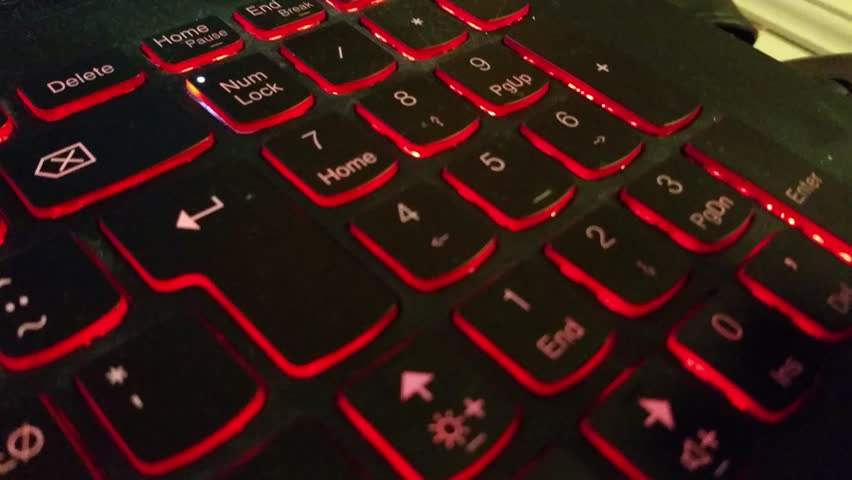 Typing numbers on keyboard, with black buttons, glowing in red | Shutterstock HD Video #13270364
