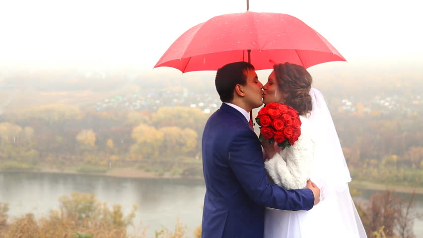 Wedding Couple Holding Red Umbrella Stock Footage Video