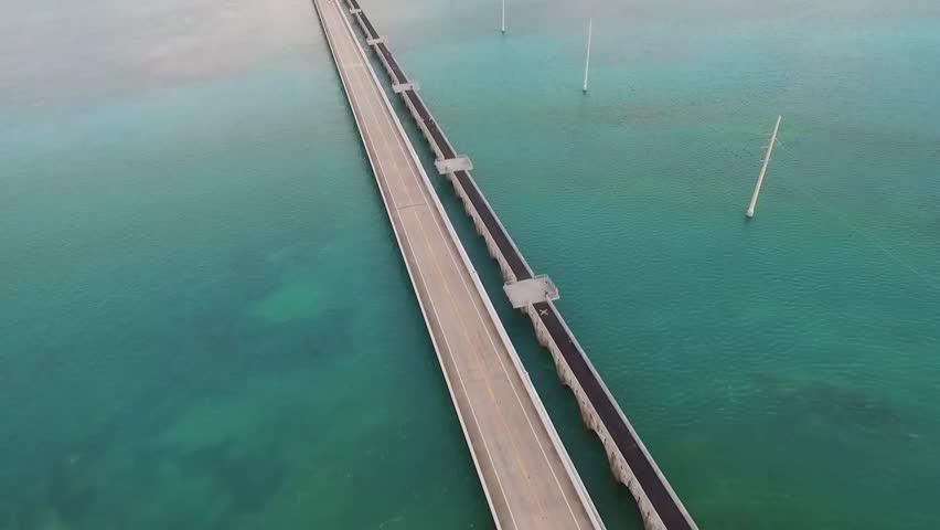 Aerial tilt view of ocean and bridge on Overseas Highway in Florida Keys at dusk