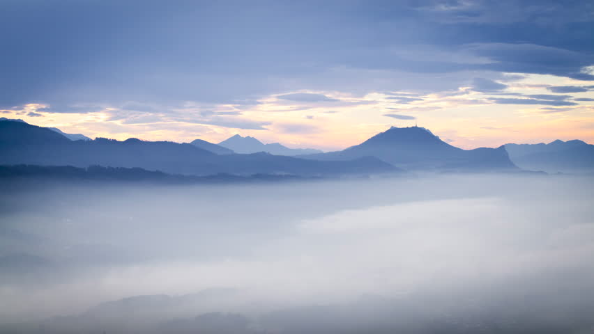 Timelapse of the evening sun and clouds with fog in the valley in the Northern Alps, Mondsee / Salzburg, Austria | Shutterstock HD Video #13331537