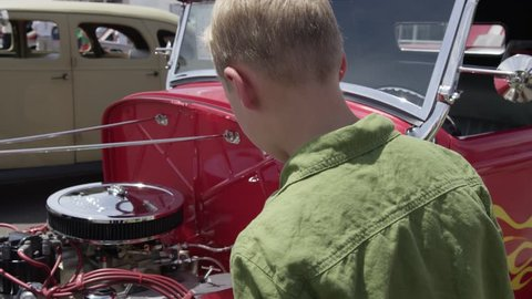 Young Teen Boy Admires Exposed Luxury Hot Rod Engine
