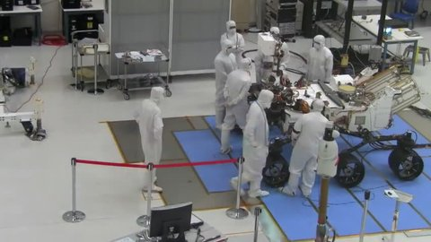 CIRCA 2010s - Time lapse footage of NASA scientists packing up the Mars Rover for shipping to launch site.