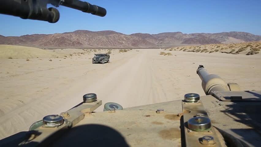 CIRCA 2010s - POV of a tank moving across the Afghan desert.