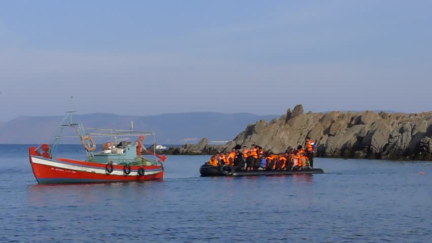 LESVOS, GREECE October 18, 2015: Refugees arriving in Greece in dinghy boat from Turkey. These Syrian, Afghanistan and African refugees land their boat at the North coast of Lesvos near Molyvos.