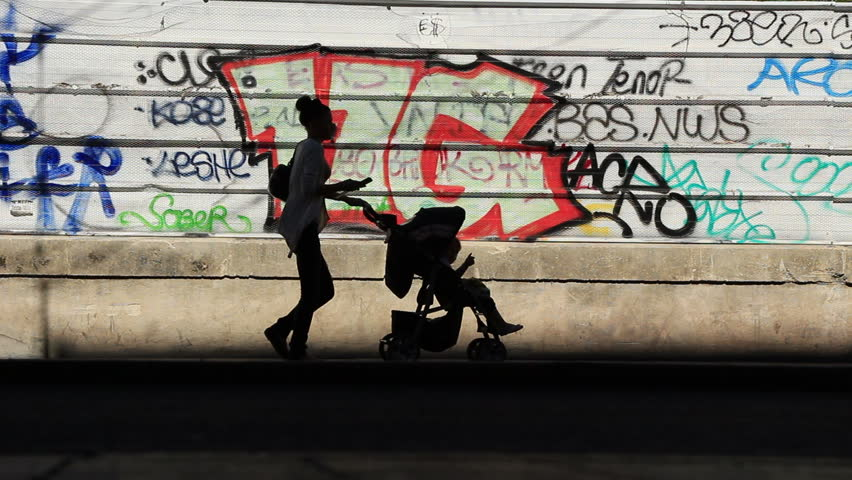 Montpellier ghetto people silhouette against graffiti background 8 .  It is the third-largest French city on the Mediterranean coast after Marseille and Nice. France. Sep 2013