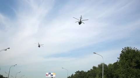 MOSCOW, RUSSIA - AUG 20, 2014: Two helicopters above Leningradskoye highway behind Moscow ring highway area.