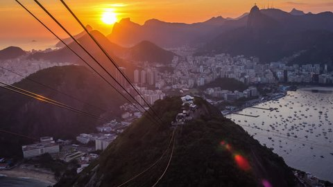 Timelapse view of sunset behind Rio de Janeiro cityscape and Christ the Redeemer statue from Sugarloaf Mountain, Rio de Janeiro, Brazil.