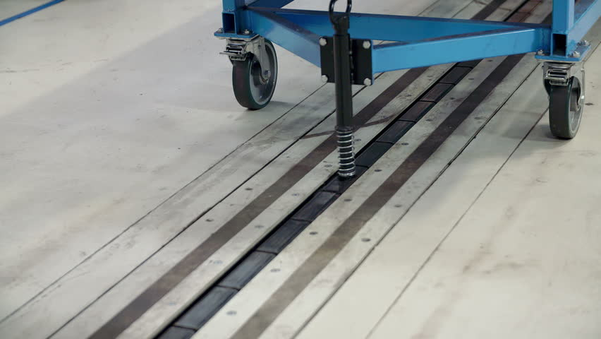 In This Video, We Can See That A Machine Is Moving On A Conveyor Belt