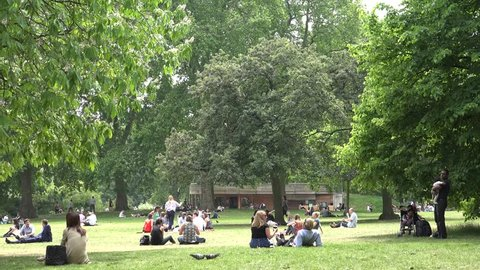 LONDON, JUNE 18, 2015 4K London James's Park, People Tourists Relaxing Resting on Grass at Picnic