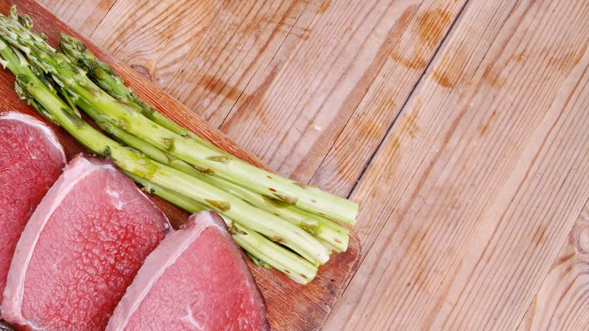 Meat food raw beef fillet on cutting board with asparagus and meat food raw beef fillet on cutting board with asparagus and thyme bundle with color ccuart Image collections