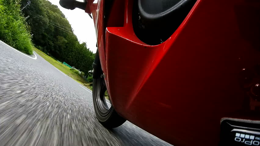 Under cowl view. Rider is traveling uphill at high speed. | Shutterstock HD Video #13655672