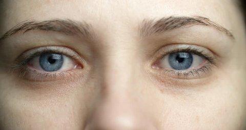 4k young woman surprised eyes closeup macro