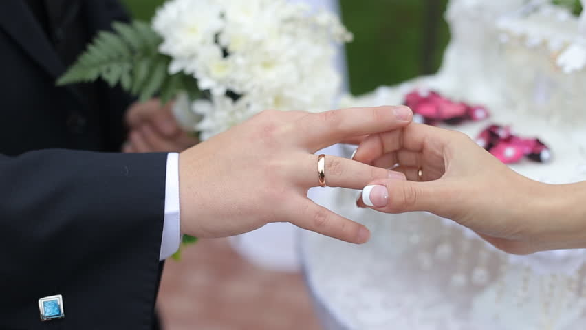 Stock Video Clip of Bride and Groom wear wedding rings Shutterstock