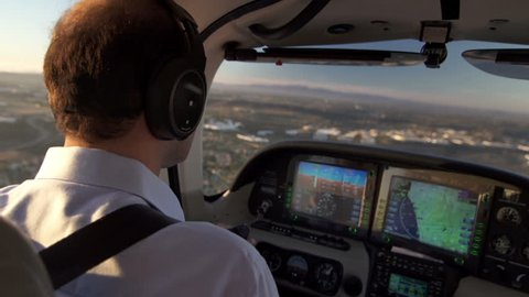 Commercial Airplane Pilot Flying at Sunset View. Pilot Observes The Digital Airplane Dashboard.