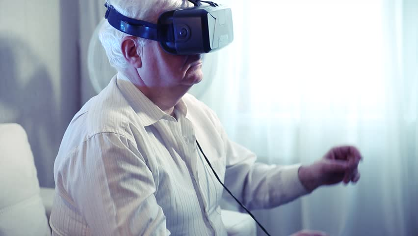 ea1bd864c9 the silver-haired old man getting experience using VR-headset glasses of virtual  reality