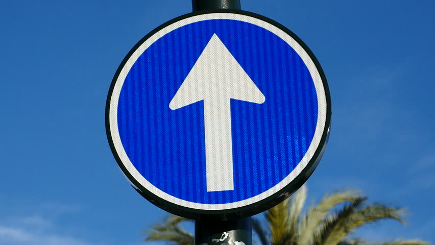 Traffic sign: mandatory sense. Filmed in the city of Murcia, Spain in January 2016.